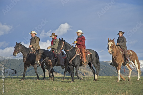 Cowboys riding the range, Montana horse ranch
