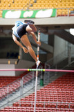 Image of a female pole vaulter in action. poster