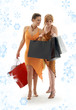 happy ladies with shopping bags and snowflakes