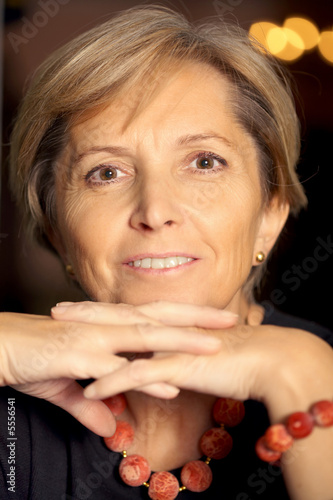Attractive mature woman looking at camera