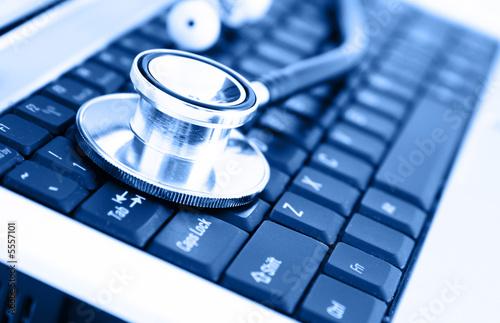 Close-up of stethoscope on laptop keyboard