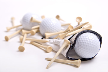 White golf glove with three golf balls