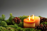 Christmas arrangement of candles and spruce branches poster