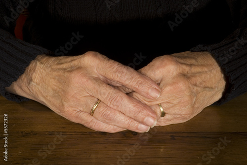 old hands with wedding ring
