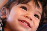 Adorable toddler smiling. Part asian, scandinavian descent. poster