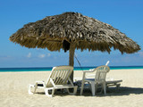 Straw sun shelter and beach chairs at Varadero beach, Cuba poster