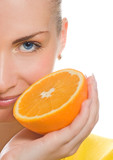 Fototapety Beautiful girl with juicy orange