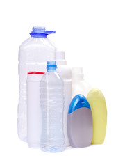 Assorted plastic bottles over white background