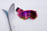 Hot Pink Ski Goggles and Skis in Snow poster