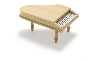 Miniature Piano on White Background