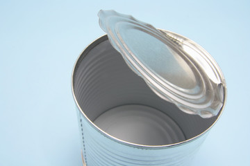 Empty Tin Can on Blue Background