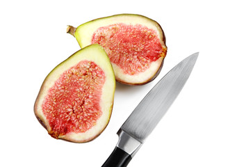 Fig, cut in half, with knife on white plate.