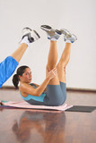 Image of a woman during an aerobics exercise in a gym. poster