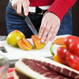 home life: woman preparing something to eat poster