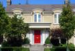 Yellow brick house with red door