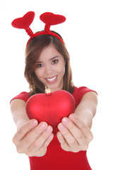 A pretty young woman holding a heart shaped Valentines ornament