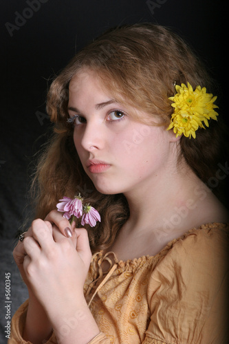 pretty young lady  with flower on her hands