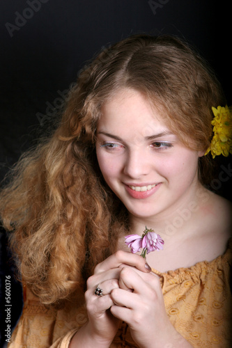 pretty young lady  with flower on her hear