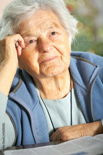 Elderly woman recalling old memories