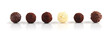 Row of assorted chocolate truffles on white background - 5602123