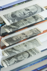 US dollar bills used as bookmarks in books