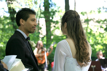 Bride and Groom Listening to Musician