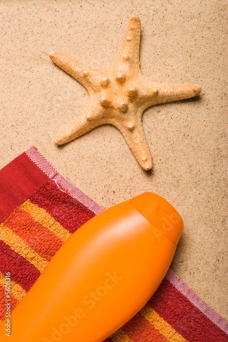 One sea star and a bottle of uv protection lotion