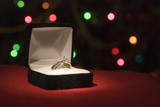 A beautiful 2 carat wedding ring with shallow DOF poster