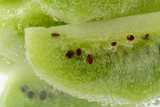 piece of kiwi fruit with carbon dioxide bubbles