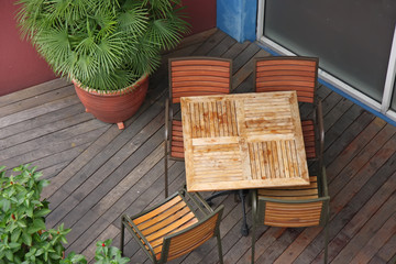casual dining restaurant with wooden table and chairs