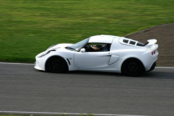 white race car on track