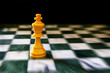 King on a chess board, against black background