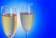 Two Champagne glasses on blue
