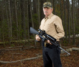 hunter with an AR-15 semiautomatic rifle poster