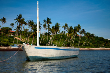 white dhow or traditional wooden boat on the islands.