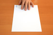 Male hand presents a blank document