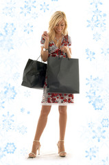 lovely blond with shopping bags and snowflakes