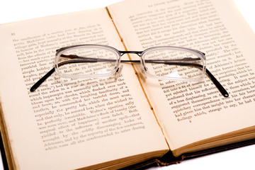 Reading - glasses on an open book
