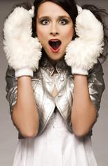 beautiful brunette winter girl wearing furry gloves