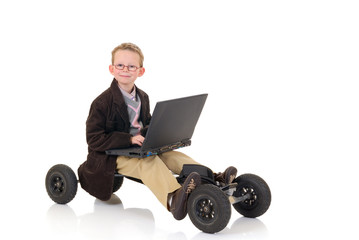 Eight year young boy speed surfing on internet library,
