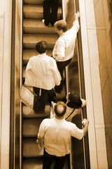 People ascending escalators and stairs..