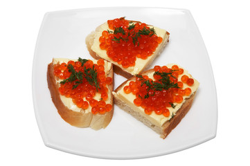 Sandwiches with red caviar on a white plate