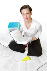 Casual student with books spread around