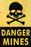 danger mines - old sign warning of land mines or minefield poster