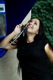 The happy girl joyfully speaks by phone. poster