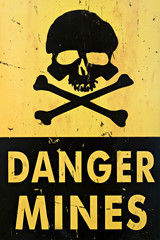 danger mines - old sign warning of land mines or minefield