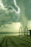 the beginning of the tornado over the lake beach poster