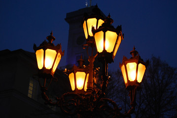 Old orange lamps in historical city in evening
