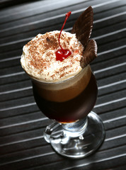 coffee cappuccino with cherry and chocolate
