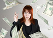 Angry and pretty redhead girl throwing Dollar banknote money